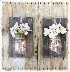 Set of Two Lit Sconces $45